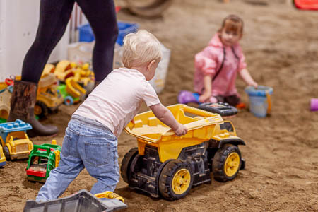 Young boy with Tonka Truck in the Sand