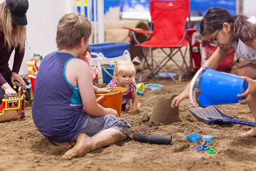Kids Playing Together in the Sand
