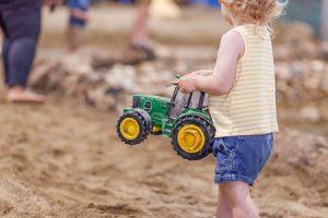 Toddler carrying John Deere Tractor